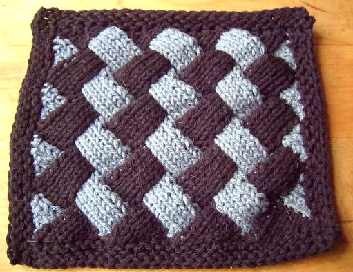 Here is a black & blue square dishcloth I made before taking the class.